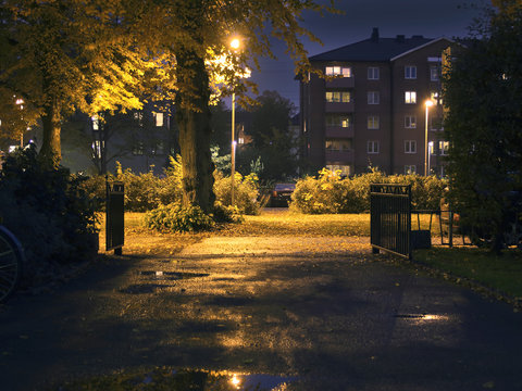 Suburban area during evening/night-time. Dark setting with some lights