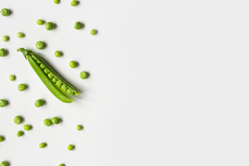 Green peas on a white background.