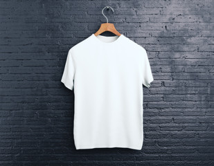 White t-shirt on brick background
