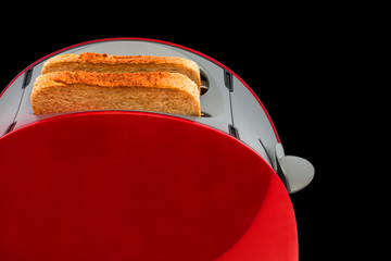 Toaster  with toasted  bread isolated on black background, Kitchen equipment. Close up. Side view