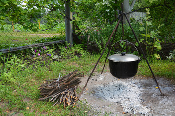 Cooking on firewood in an outdoor camp. Kitchen in the camp.