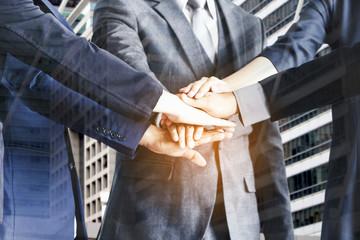 Business teamwork stack hands on blur office building background- Team work concept