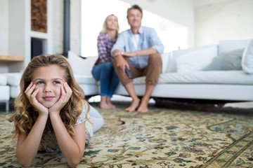 Family watching television together in living room