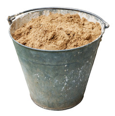 Iron old construction bucket with clean sand.