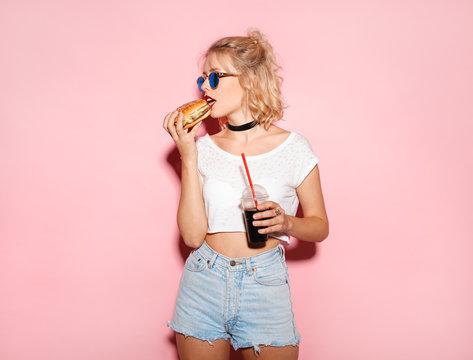 Pretty girl biting a burger