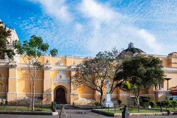 View of the side elevation of La Merced Church close to sunset in historic center of Antigua, Guatemala.