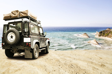 summer time and car on beach with landscapeo of cliffs