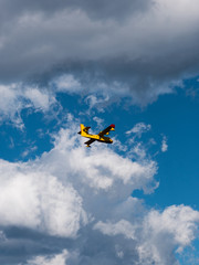 Yellow fire fighter airplane in action