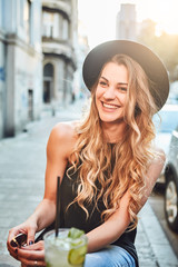 Portrait of young woman with hat smiling