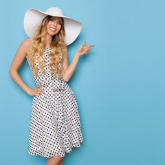 Summer Woman In White Sun Hat Is Smiling And Pointing