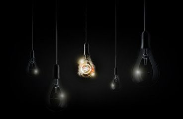 Glowing abstract futuristic light bulb is hanging between a lot of turned off light bulbs on dark black background, vector illustration