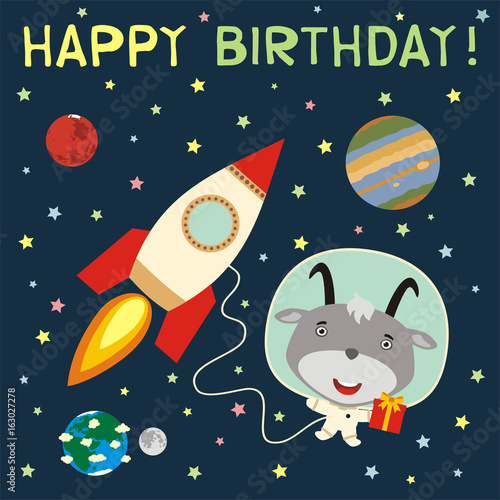 Happy birthday! Funny goat with gift in spacesuit next to rocket in space. Birthday card with goat in cartoon style.