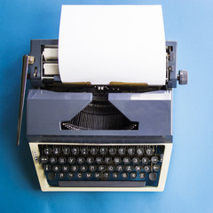 Typewriter on a blue background with free space for text