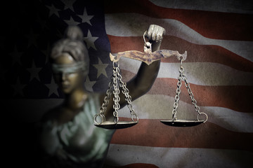 Lady Justice on U.S flag background