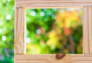 Picture frame on blurred tree bokeh background using wallpaper or background.
