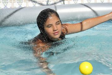 girl swims in an inflatable pool enjoying life