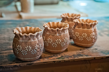 Pottery production. How to make clay products, jugs, pots, vases. Clay workshop. Painting and modeling of clay products