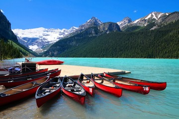 Red canoes in the blue waters of Lake Louise, Banff National Park, Alberta, Canada