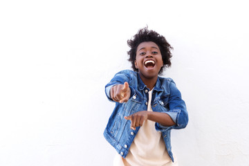 Cheerful young black woman pointing fingers
