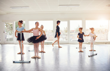 Group of little girls practicing in ballet class