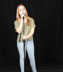 girl speaking into mic