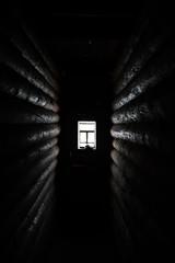 sunlight coming through the wooden window in old dark room