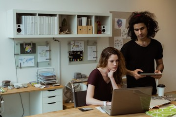 Business colleagues working together at desk