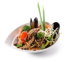noodles with mussels in a white plate
