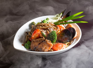 noodles with vegetables, meat and mussels