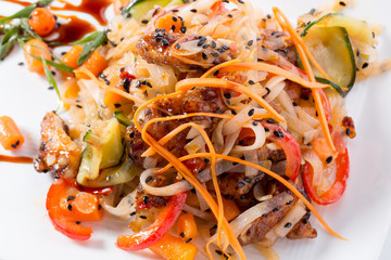 noodles with vegetables on a white plate