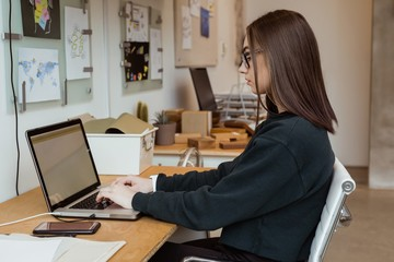 Female executive working on laptop at desk