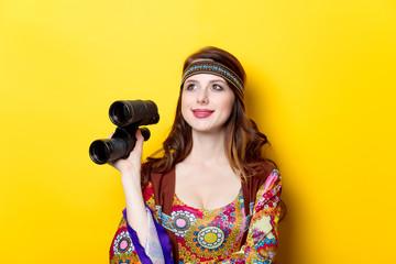Young hippie girl with binoculars