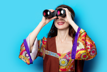 Young hippie girl with binoculars