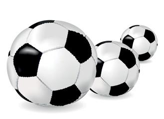 Black and white soccer balls