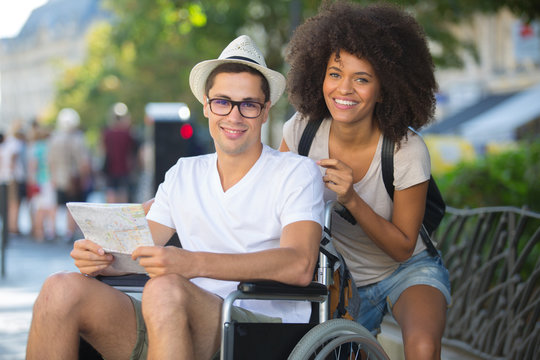 man in wheelchair and girlfriend on holidays