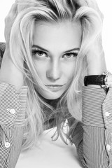 Black and white casual portrait of young beautiful blonde woman