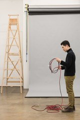 Full length of photographer rolling wire