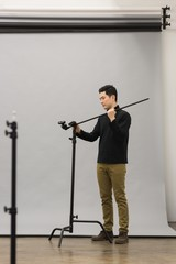 Full length of man adjusting tripod