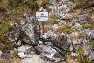 MINAS GERAIS, BRAZIL - JUL 01, 2017 - Info board indicating camping area in Serra Fina traverse in Mantiqueira Range