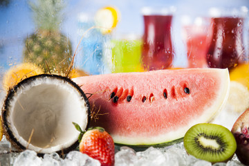 Fresh tropical fruits, Summer drink and palm branch
