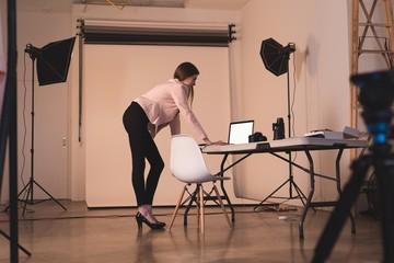 Full length of model using laptop