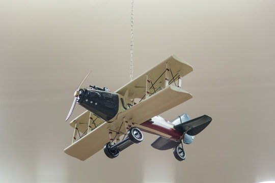 Wooden model airplane on a grey  background