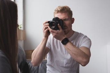 Male photographer photographing model