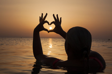 Girl in love enjoying tender moments at sunset during holiday with best friends. Emotional concept of happy exclusive lifestyle moment, sharing time, relaxing with nature contact.