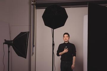 Photographer holding camera flash