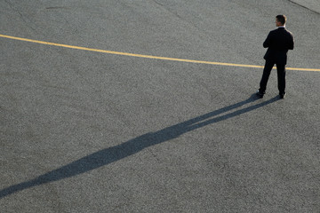 A U.S. Secret Service agent stands guard on a tarmac while President Donald Trump boards Air force One