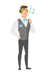 Groom listening to music in headphones.