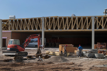 construction site of a supermarket with wooden roof construction
