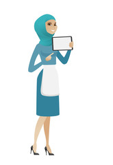 Young muslim cleaner holding tablet computer.