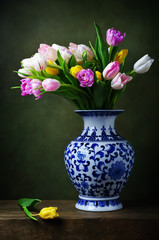 Still life with colorful tulips in a chinese vase